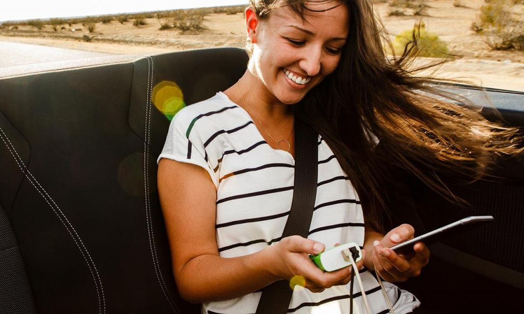 belkin-portable-charging-photo-lifestyle-roadtrip-convertible.jpg